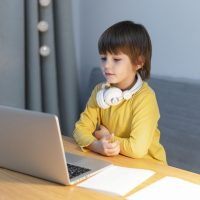 side-view-child-online-school-interactions
